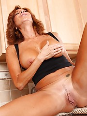Ragged-looking Latina redhead teasing her MILF pussy on camera